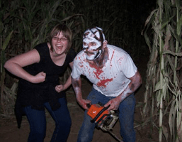 Scary Chainsaw Mask Guy and Happy Person Posing Together