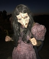 Creepy Lady Wearing a Mask with Very Long Nose and Old Fashion Dress